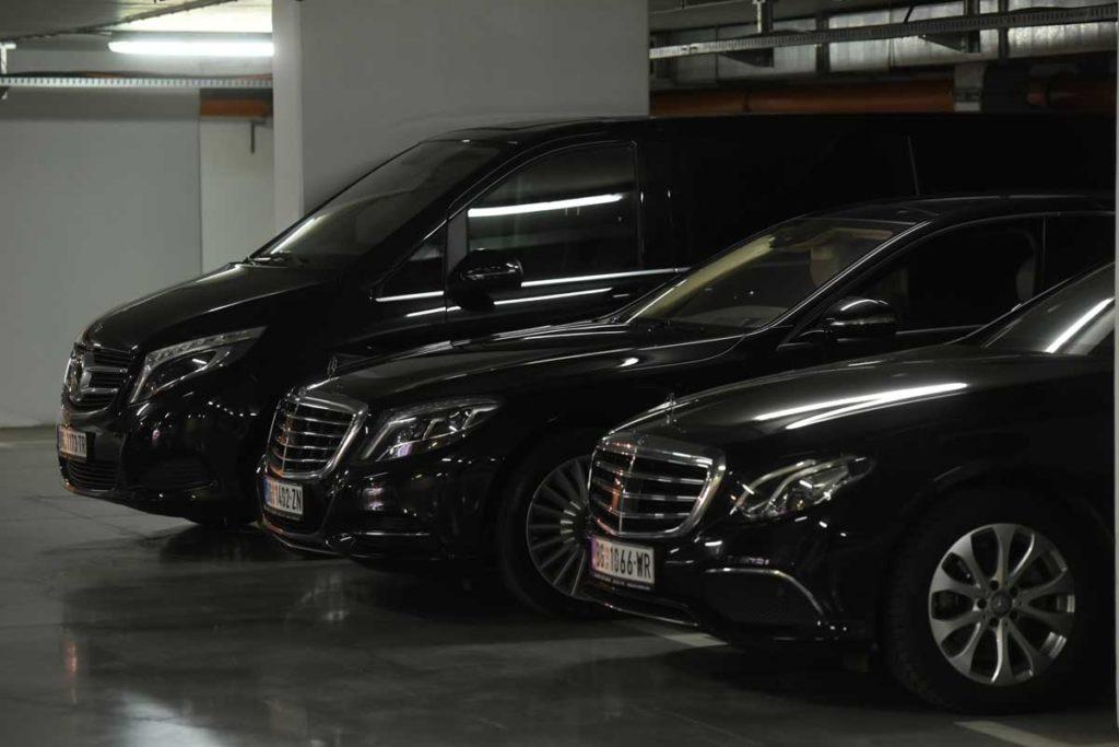 Three Mercedes vehicles parked next to each other in an underground garade